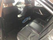 Bán xe Toyota Camry 2.0E SX 2011, màu đen, xe nhập giá 665 triệu tại Hải Phòng