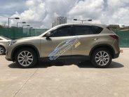 Bán Mazda CX 5 đời 2014, màu vàng cát, giá chỉ 690 triệu giá 690 triệu tại Tp.HCM