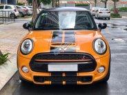Cần bán xe Mini Cooper sản xuất năm 2014, màu vàng, xe nhập giá 1 tỷ 230 tr tại Tp.HCM