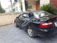 Cần bán xe Mazda 626 đời 2001, màu đen chính chủ, 135tr giá 135 triệu tại Nam Định