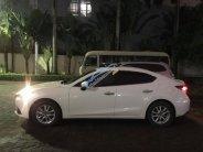 Cần bán xe Mazda 3 Sedan 1.5AT 2015 màu trắng, xe cọp nữ chạy kĩ còn mới tinh giá 587 triệu tại Tp.HCM