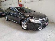 Cần bán xe Toyota Camry E 2015, màu đen, xe cực đẹp, giá thương lượng giá 920 triệu tại Tp.HCM