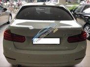 Bán BMW 3 Series 320i sản xuất 2015, màu trắng, xe nhập chính chủ giá 950 triệu tại Tp.HCM