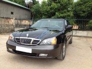 Bán Daewoo Magnus sản xuất năm 2004, màu đen số tự động giá cạnh tranh giá 225 triệu tại Tp.HCM