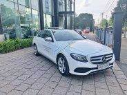 Bán xe Mercedes E250 màu trắng 2018 chính hãng. Trả trước 750 triệu nhận xe với gói vay ưu đãi  giá 2 tỷ 290 tr tại Tp.HCM
