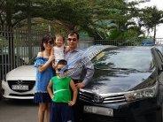 Bán xe Toyota Corolla altis 1.8MT đời 2015, màu đen số sàn, 580 triệu giá 580 triệu tại Tp.HCM