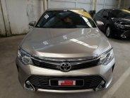 Bán xe Toyota Camry 2.0 E sản xuất 2015, màu vàng giá cạnh tranh giá 930 triệu tại Tp.HCM