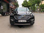 Bán Hyundai Santa Fe SE 2.0 AT AWD sản xuất năm 2016, màu đen giá 1 tỷ 15 tr tại Hà Nội
