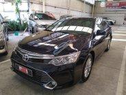 Cần bán Toyota Camry 2.0E, đổi màu xanh nhớt sơn trong hãng, mới đi 39.000km, xe cực đẹp, cực chất giá 950 triệu tại Tp.HCM