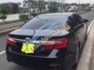 Bán Toyota Camry đời 2013, màu đen giá 850 triệu tại Tp.HCM