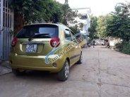 Cần bán Chevrolet Spark LT sản xuất 2010, màu vàng xe gia đình  giá 110 triệu tại Sơn La