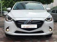 Bán xe Mazda 2 Hatchback 1.5 AT 2015, màu trắng (Nhập) giá 538 triệu tại Hà Nội