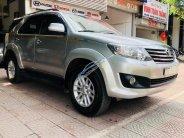Bán xe Toyota Fortuner V 2.7 4x4 AT năm 2014, màu bạc giá 785 triệu tại Hà Nội
