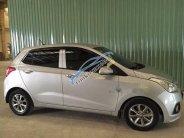 Cần bán gấp xe cũ Hyundai Grand i10 AT 2014, màu bạc giá 345 triệu tại Bình Dương
