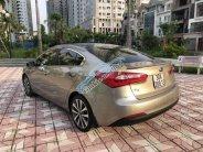 Bán xe Kia K3 1.6AT năm sản xuất 2015, màu vàng cát giá 530 triệu tại Hà Nội