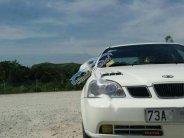 Bán Daewoo Lacetti Ex năm sản xuất 2004, màu trắng chính chủ giá cạnh tranh giá 155 triệu tại Quảng Bình