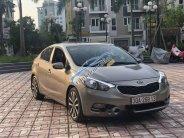 Bán Kia K3 1.6AT sản xuất năm 2015, màu vàng cát giá 530 triệu tại Hà Nội