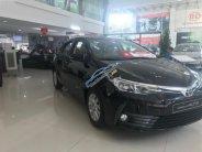 Cần bán xe Toyota Corolla Altis 1.8E AT sản xuất năm 2018, màu đen, mới 100% giá 707 triệu tại Hà Nội