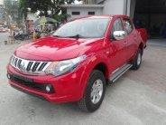 Mitsubishi Cầu Diễn bán Triton 4x2AT màu đỏ, giao ngay giá 573 triệu tại Hà Nội