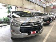 Bán xe Innova E sản xuất 2016 màu bạc giá 740 triệu tại Tp.HCM
