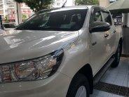Bán xe Toyota Hilux E(4x2) AT năm sản xuất 2018, màu trắng, nhập khẩu giá 695 triệu tại Hà Nội