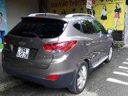 Cần bán Hyundai Tucson 2.0 AT 4WD năm 2011, màu xám, xe nhập   giá 565 triệu tại Hà Nội