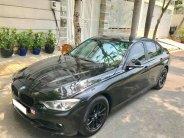 Cần bán xe BMW 3 Series 320i đời 2013, màu đen giá 845 triệu tại Tp.HCM