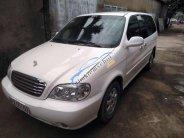Cần bán Kia Carnival 2005, màu trắng, 195 triệu giá 195 triệu tại Tp.HCM
