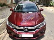 Cần bán lại xe Honda City TOP CVT sản xuất 2017, màu đỏ giá 595 triệu tại Tp.HCM