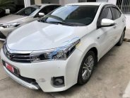 Bán ô tô Toyota Corolla altis 2015, màu trắng  giá 700 triệu tại Tp.HCM