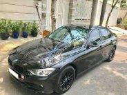 Bán BMW 3 Series 320i năm 2013, màu đen, giá 845 triệu giá 845 triệu tại Tp.HCM