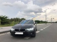 Bán xe BMW 320i năm 2017, màu đen như mới giá 1 tỷ 280 tr tại Tp.HCM