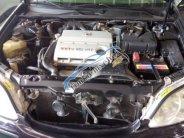 Cần bán lại xe Toyota Camry năm 2006, màu đen giá 380 triệu tại Hà Nội