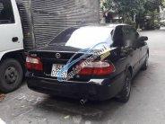 Cần bán gấp Mazda 626 năm 2002, màu đen giá 187 triệu tại Tp.HCM