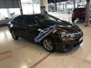 Bán ô tô Toyota Corolla altis 1.8L sản xuất năm 2015, màu nâu giá 665 triệu tại Tp.HCM