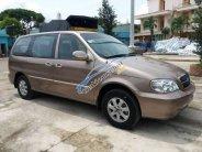 Cần bán xe Kia Carnival GS sản xuất 2009, màu vàng số tự động giá cạnh tranh giá 268 triệu tại Tiền Giang