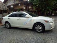 Gia đình em bán Camry LE 2008 trắng tự động giá 595 triệu tại Tp.HCM