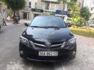 Cần bán Toyota Corolla altis 2.0V đời 2013, màu đen giá 628 triệu tại Hà Nội