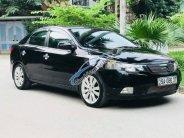 Bán Kia Cerato 1.6AT đời 2011, màu đen, nhập khẩu nguyên chiếc giá 410 triệu tại Hà Nội