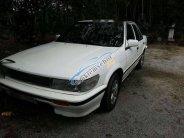 Cần bán Nissan Bluebird 1989, màu trắng, máy rất êm giá 39 triệu tại Bình Dương