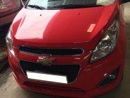 bán em Chevrolet Spark 2015 số tự động màu đỏ giá 263 triệu tại Tp.HCM