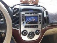 Cần bán Santa Fe 2009 màu đen, số sàn, xăng, xe nhập nguyên chiếc giá 440 triệu tại Tp.HCM