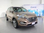 Cần bán Hyundai Tucson 2.0 ATH năm sản xuất 2018, màu nâu giá 828 triệu tại Tp.HCM