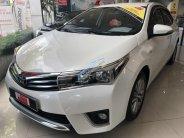 Bán ô tô Toyota Corolla Altis G sản xuất năm 2015, màu trắng, giá tốt giá 699 triệu tại Tp.HCM