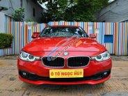 Cần bán BMW 3 Series 320i LCI sản xuất 2015, màu đỏ, model 2016 giá 1 tỷ 170 tr tại Tp.HCM