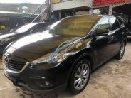 Cần bán Mazda CX 9 sản xuất 2014, màu đen giá 1 tỷ 160 tr tại Tp.HCM