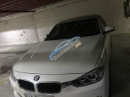 Bán ô tô BMW 3 Series 320i đời 2013, màu trắng chính chủ giá 910 triệu tại Tp.HCM