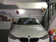 Cần bán BMW 3 Series 320i màu trắng, xe nhập giá 880 triệu tại Tp.HCM