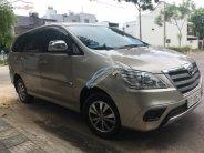 Cần bán Toyota Innova 2.0E năm 2016, màu ghi vàng  giá 590 triệu tại Đà Nẵng