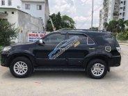 Bán Toyota Fortuner 2014, màu đen số tự động  giá 735 triệu tại Hà Nội